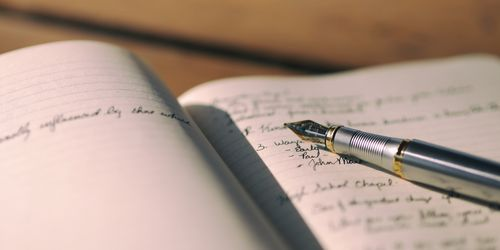 Notepad with pen for writing a personal summary